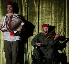 Accordion, violin, green curtain
